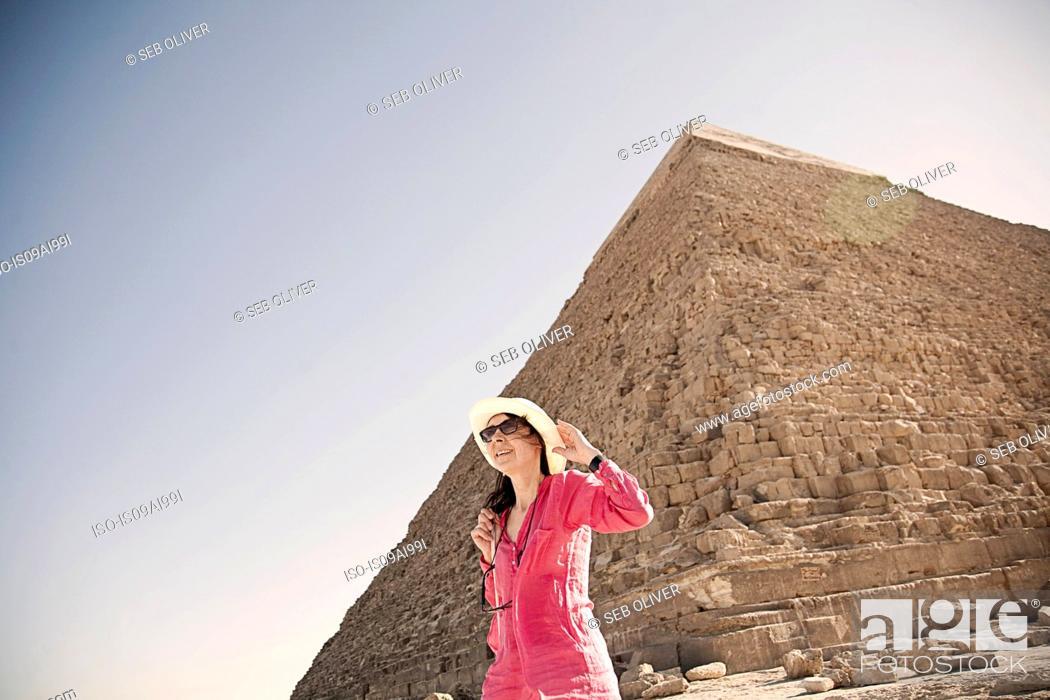 Stock Photo: Mature woman tourist at The Great Pyramid of Giza, Egypt.