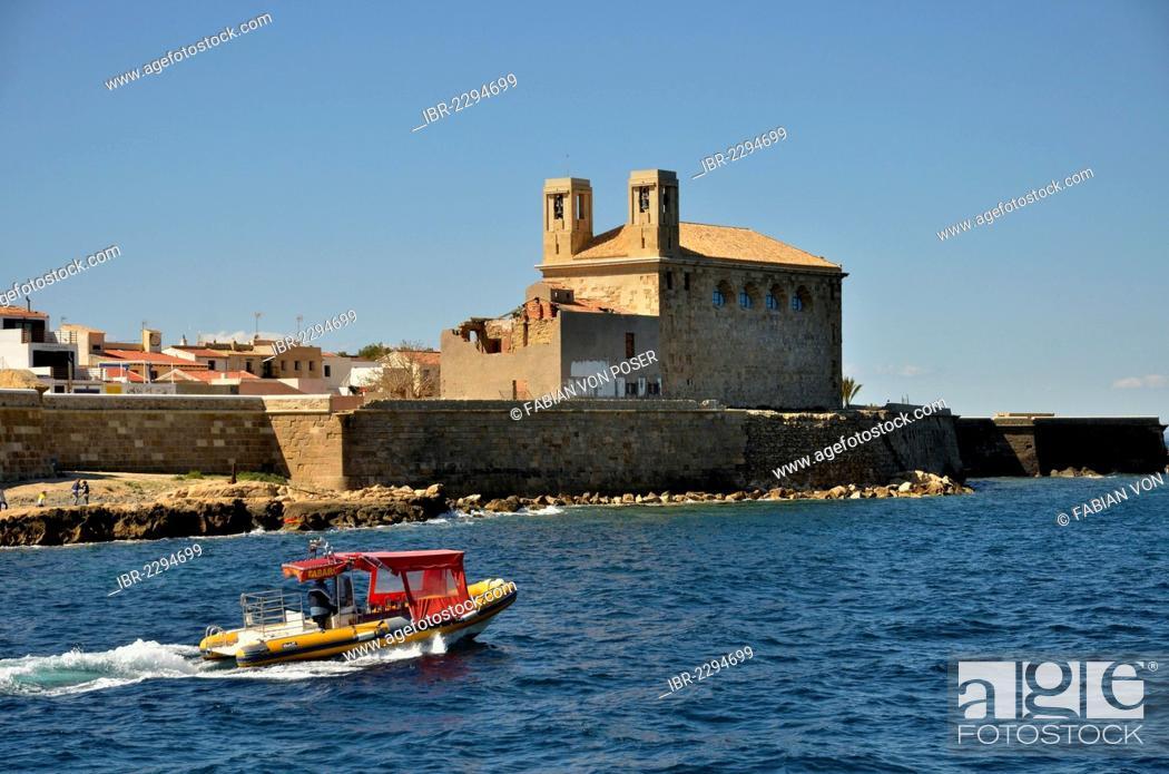 Stock Photo: Boat in the harbour of the Island of Tabarca, church Iglesia de San Pedro at back, Isla de Tabarca, Costa Blanca, Spain, Europe.