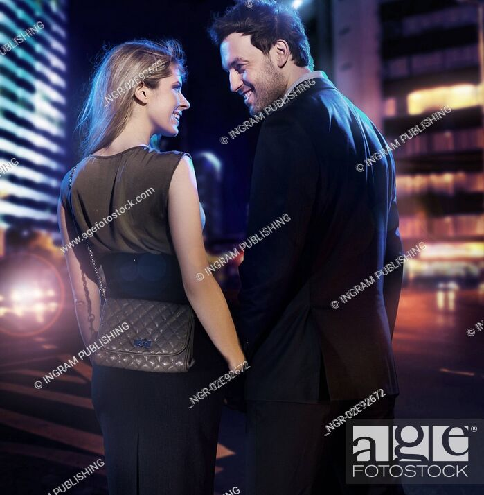 Stock Photo: Amazing couple in love over the city background.