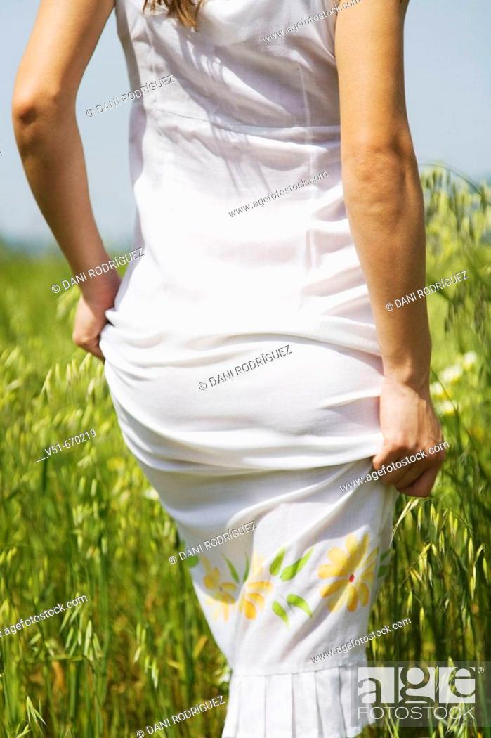 Stock Photo: Woman in white dress in the countryside.