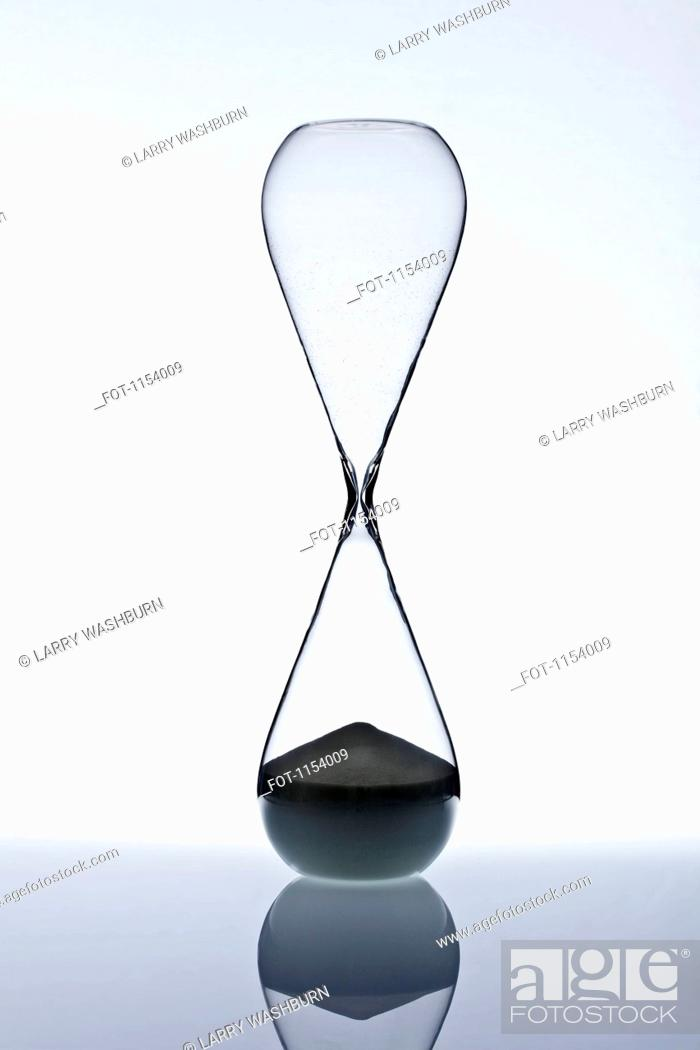 Stock Photo: Sand at the bottom of an hourglass.