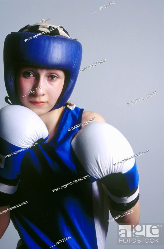 Stock Photo: Portrait of female boxer.