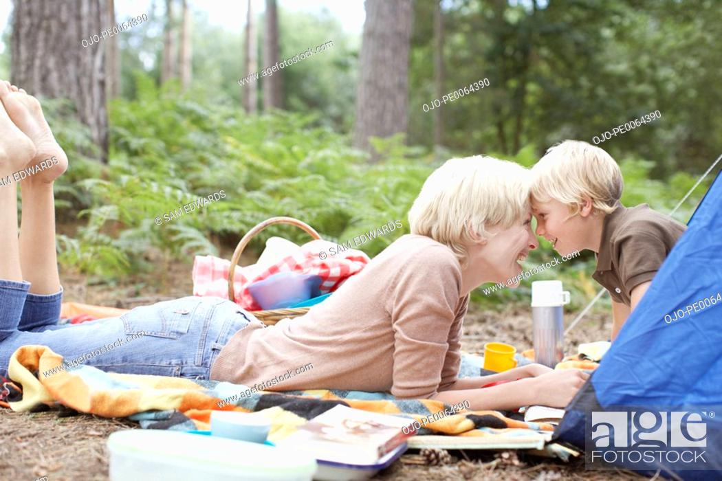 Stock Photo: Mother and son camping.