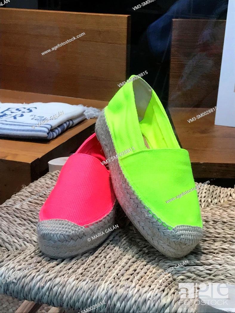 Stock Photo: Espadrilles in a shop window.