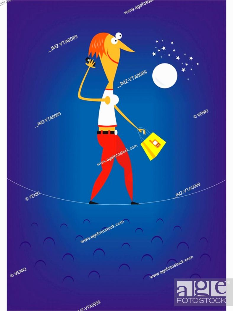 Stock Photo: A woman talking on a cell phone walking a high wire.