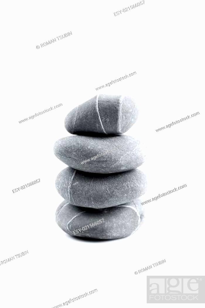 Stock Photo: Pyramid of stones over white.