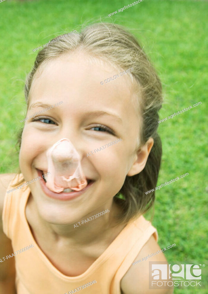 Stock Photo: Girl with popped gum bubble on nose.
