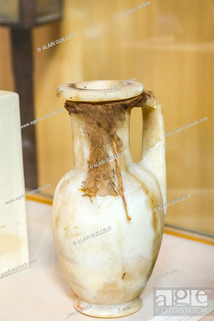 Stock Photo: Egypt, Cairo, Egyptian Museum, from the tomb of Yuya and Thuya in Luxor : Vase in alabaster, with a small cloth tied to the neck.