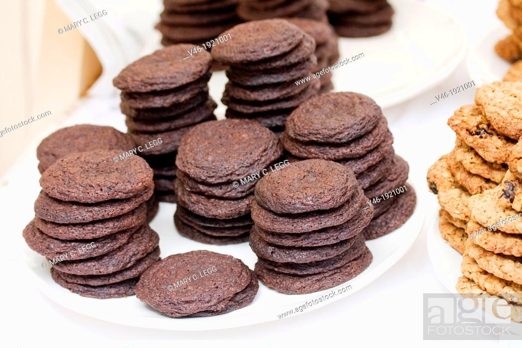 Stock Photo: Dark Chocolate Fudge Cookies using whole grains in famer's market  Enticing chocolate cookies on a plate in a baked goods stall  It is a fresh market with bio.