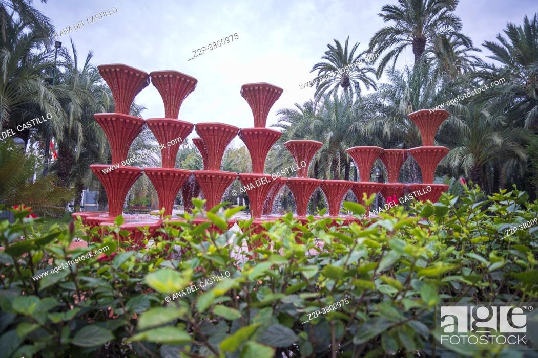 Stock Photo: Elche Alicante Spain on February 24, 2021 red fountain at public park.