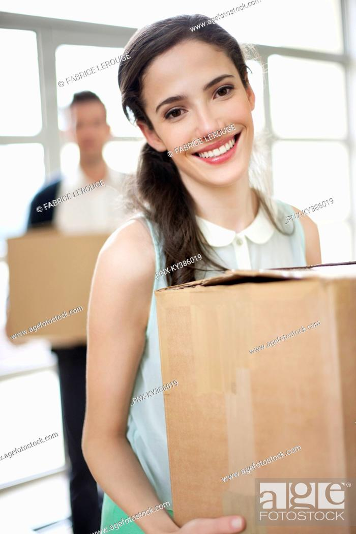 Stock Photo: Couple carrying cardboard boxes at their new home.