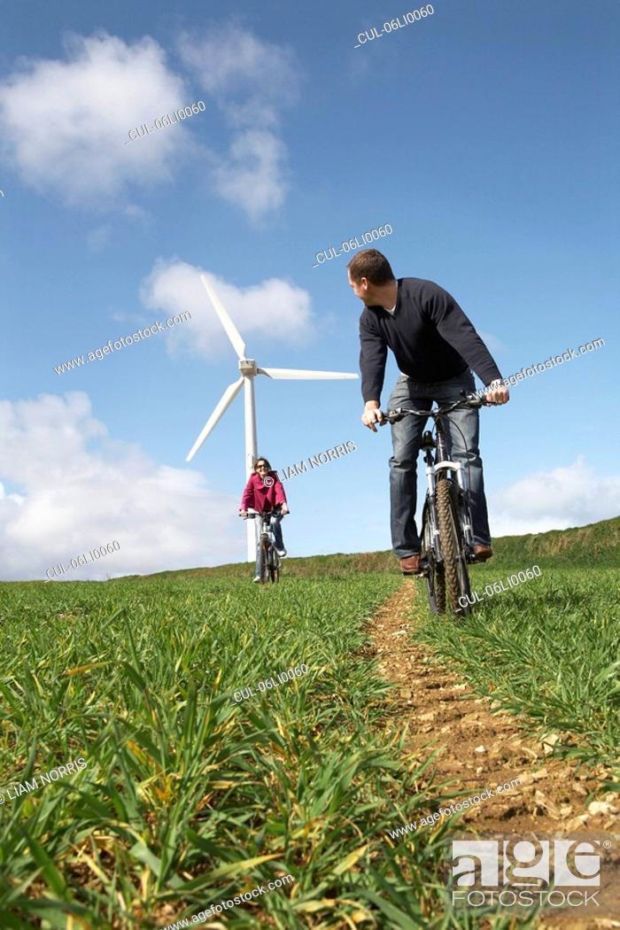 Stock Photo: Couple riding bikes.