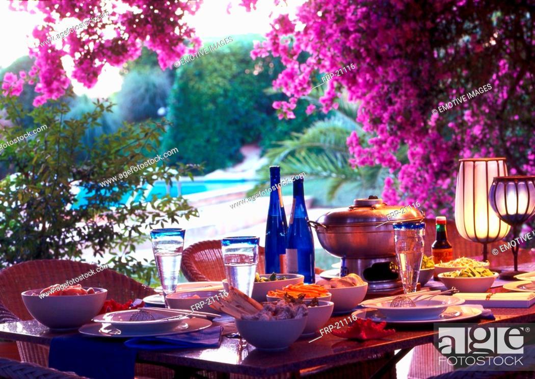 Stock Photo: Summery table setting beneath bougainvillea.