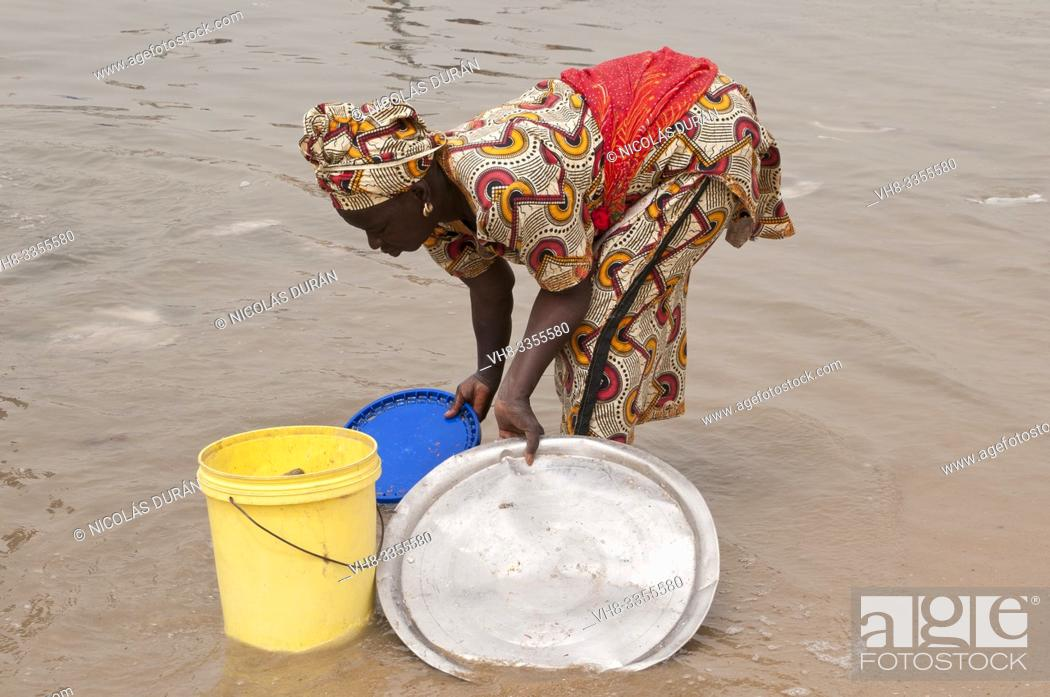 Stock Photo: Senegalese woman working.