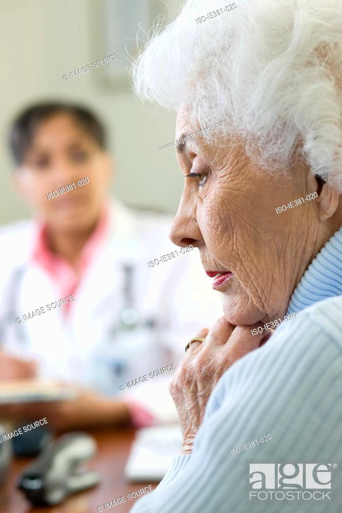 Stock Photo: A worried woman at the doctors.