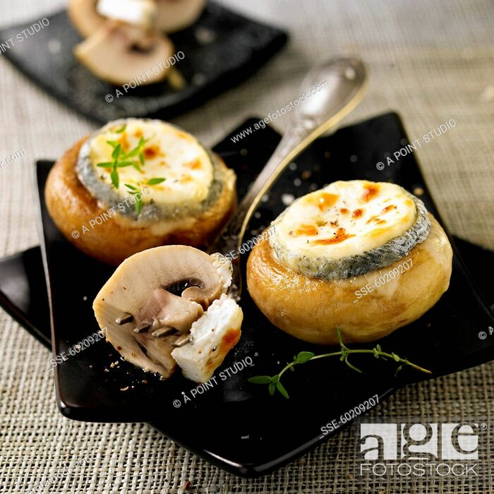 Stock Photo: Button mushrooms stuffed with goat's cheese.