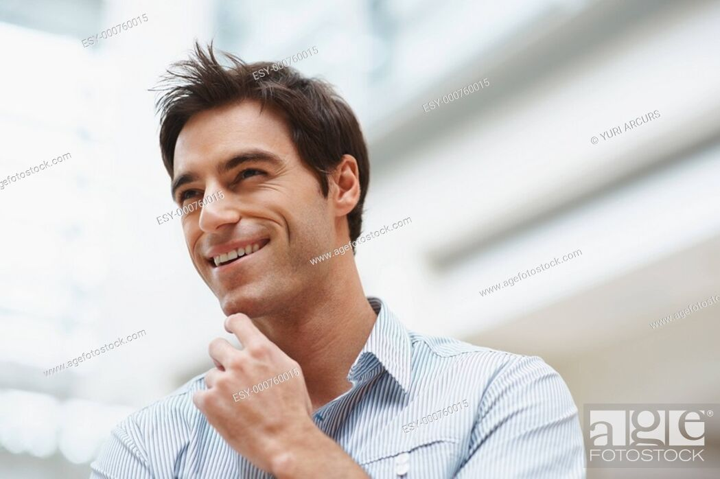 Stock Photo: Closeup of a happy young business man looking away with copyspace.