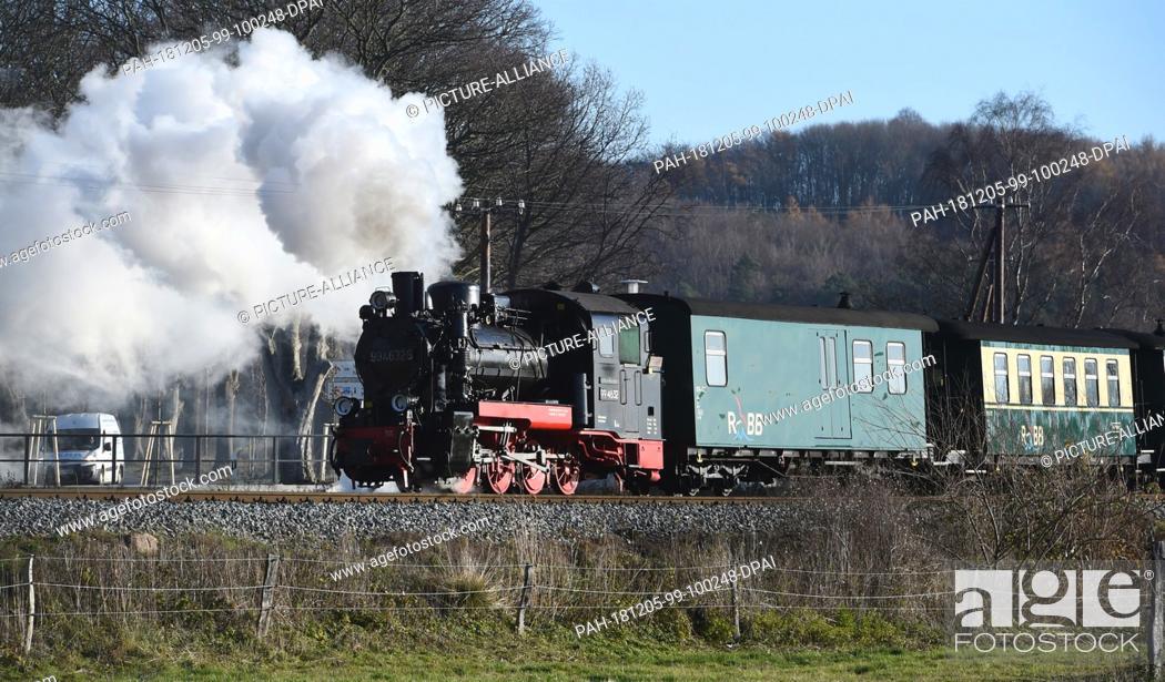 "Stock Photo: 05 December 2018, Mecklenburg-Western Pomerania, Sellin: The """"Rasende Roland"""" travels across the island of Rügen. The narrow-gauge railway on Germany's."