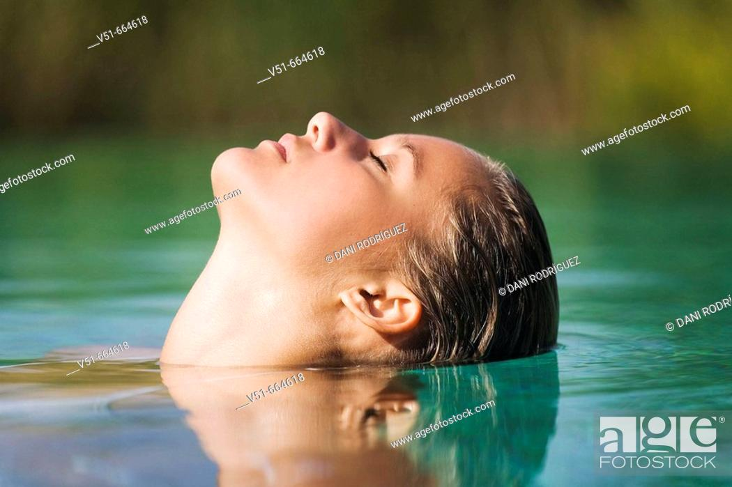 Stock Photo: Young woman in swimming-pool.