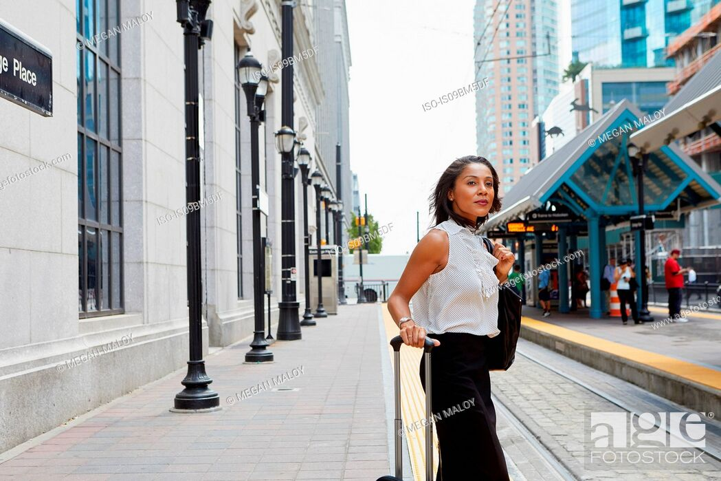 Stock Photo: Businesswoman waiting on light rail platform.