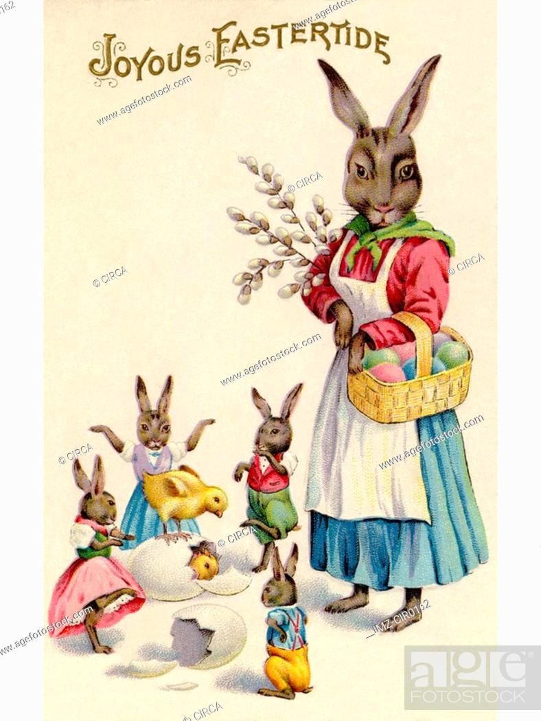 Stock Photo: A vintage Easter postcard of a rabbit and her rabbit children playing around hatching eggs.