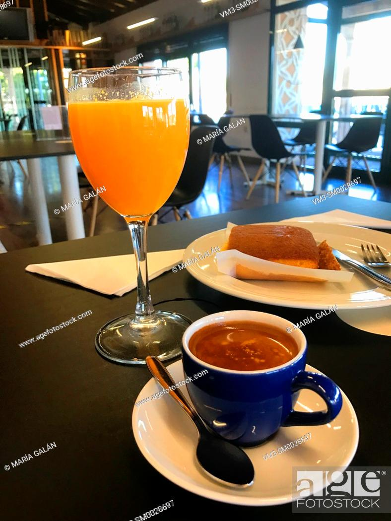Stock Photo: Cup of coffee, glass of orange juice and sobao pasiego in a cafeteria. Spain.