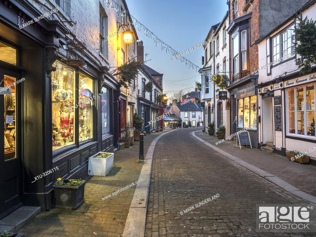 Stock Photo: Christmas lights across Kirkgate in Ripon at dusk North Yorkshire England.
