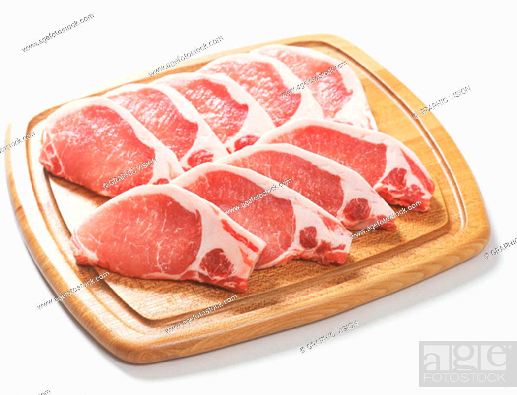 Stock Photo: Uncooked Pork Chops on Cutting Board.
