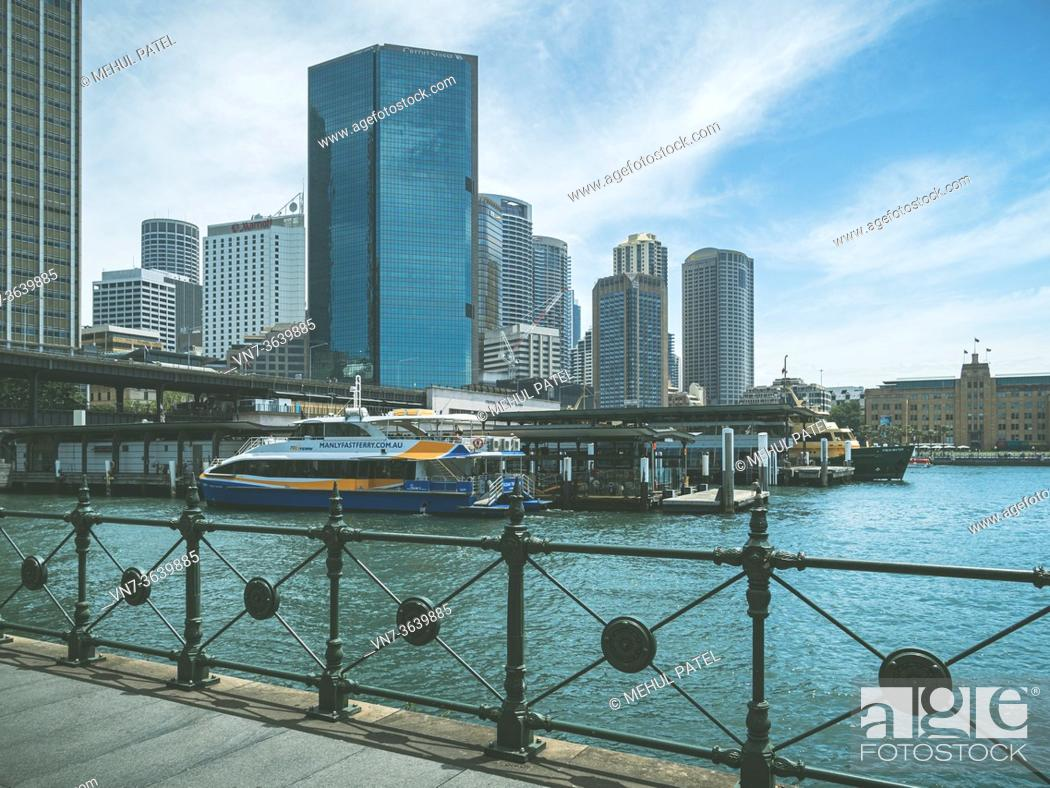 Stock Photo: Circular Quay transport hub in downtown Sydney with ferries docking on the harbour and the railway station on the bridge directly above the ferry docks.