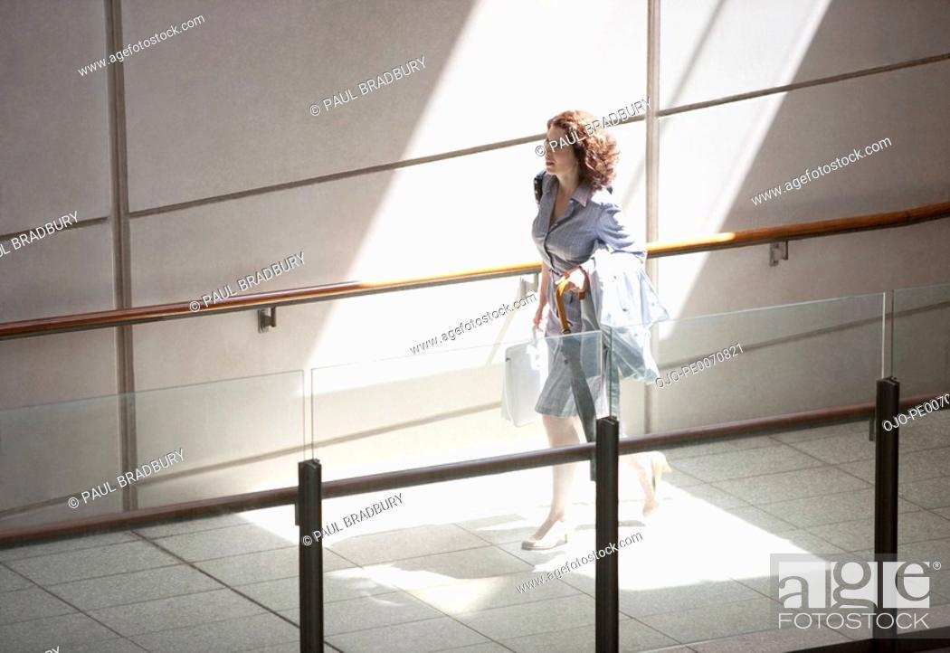Stock Photo: Businesswoman rushing up ramp.