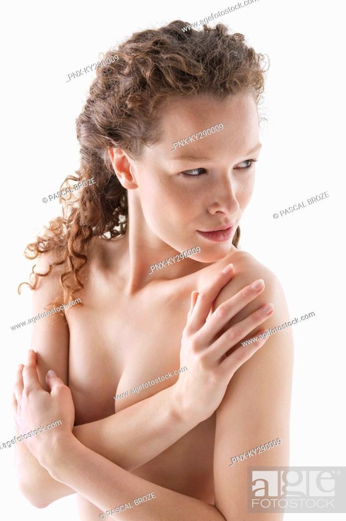 Stock Photo: Naked woman hugging herself.