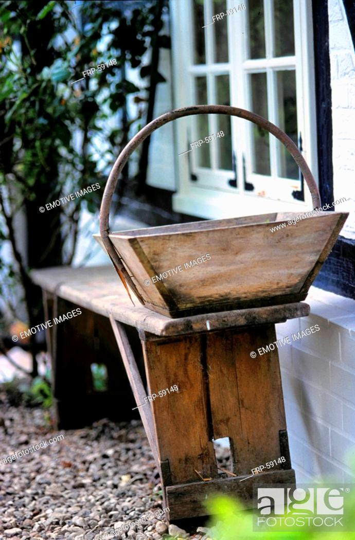 Stock Photo: Old wooden bench and wooden basket.
