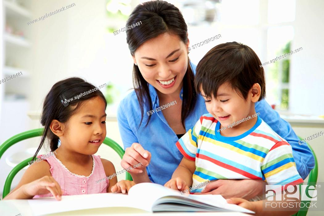 Stock Photo: Mother Helping Children With Homework.