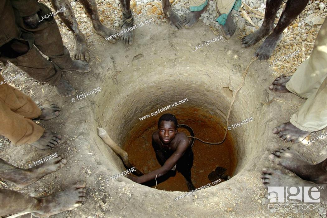 Stock Photo: A man in a well in CAR  In 2005, fighting broke out between government troops and various rebel groups in the northwest of the Central African Republic CAR.