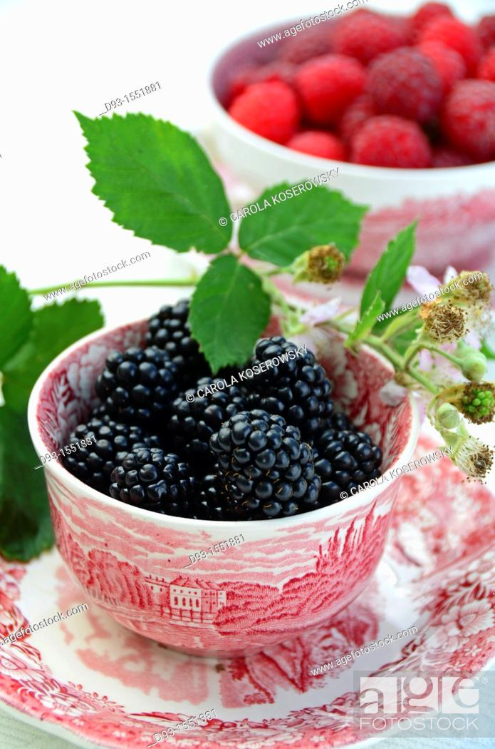Stock Photo: blackberries in a antique bowl with leaves.