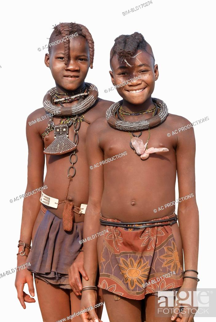 Photo de stock: Black girls wearing traditional clothing and jewelry.