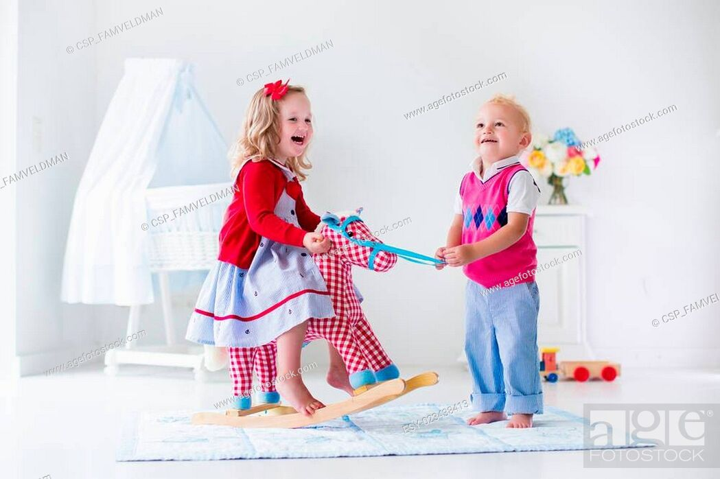 Stock Photo: Kids playing with rocking horse.