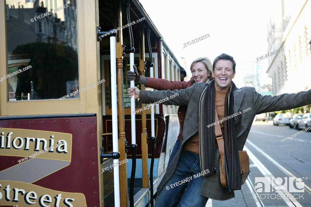 Stock Photo: Mature couple on a trolley car.