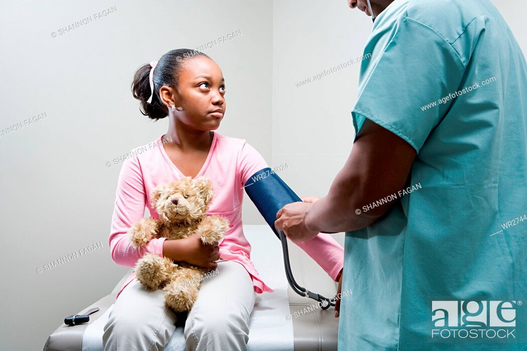 Stock Photo: Girl having a check up.