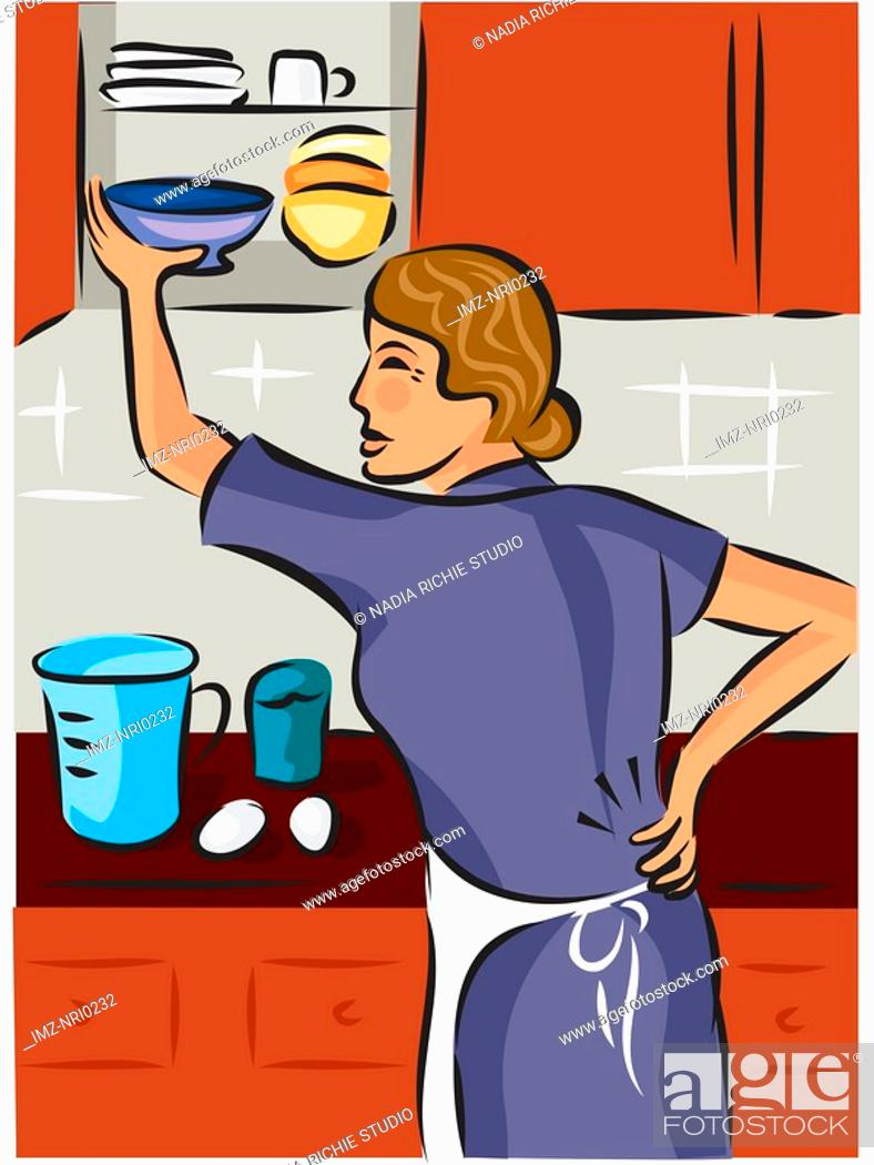 Stock Photo: Woman holding her back while putting dishes away in the cupboard.