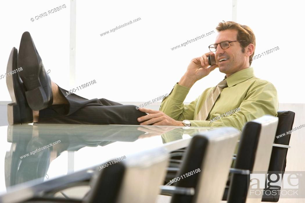Stock Photo: Business man using mobile phone in conference room.