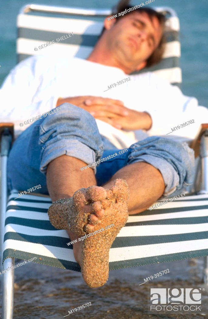 Stock Photo: relaxing on at the beach.