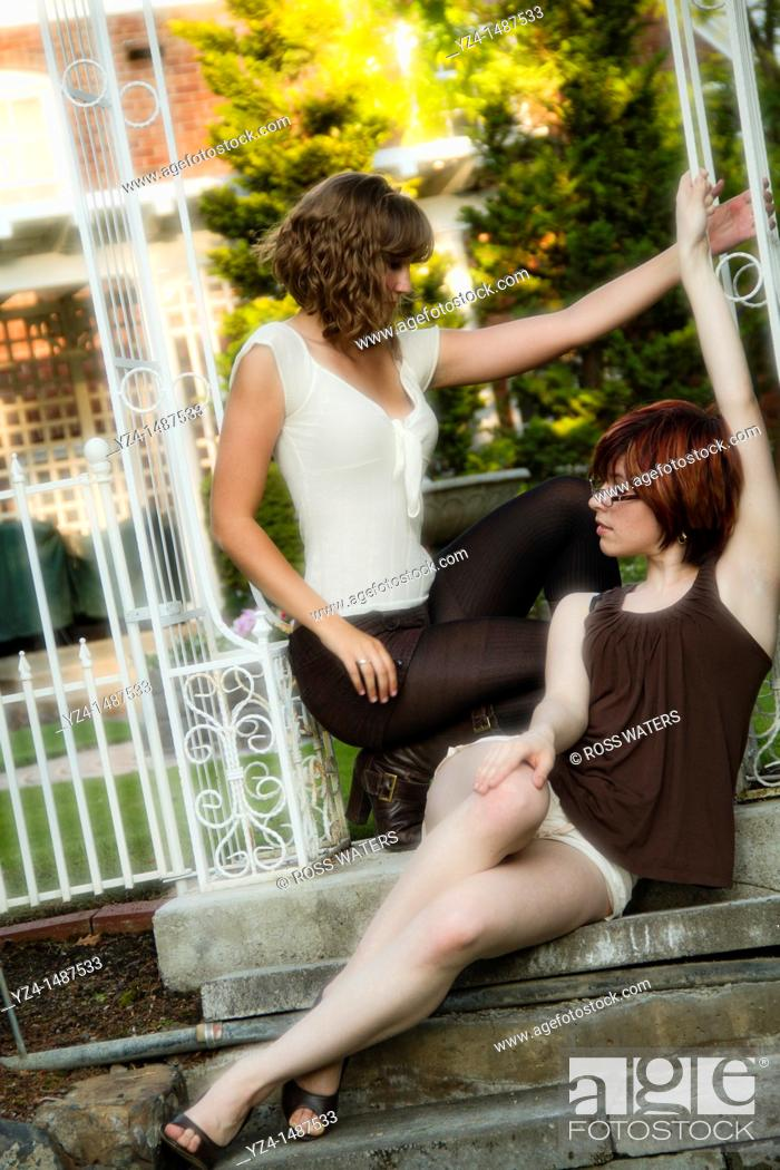 Stock Photo: young women posing in the evening.