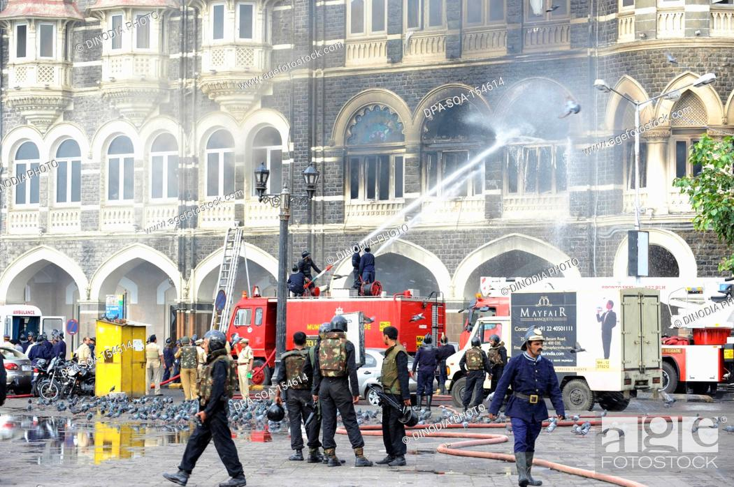 Stock Photo: Fire Brigade trying to extinguish the fire in a old wing of Taj Mahal hotel ; after Terrorist attack by Deccan Mujahedeen on 26 November 2008 in Bombay Mumbai ;.