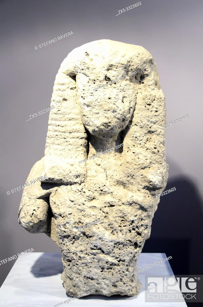 Stock Photo: Upper body of a female over life-size statue made of poros stone. It wears a belt and epiblema, a cape preserved over the right shoulder.