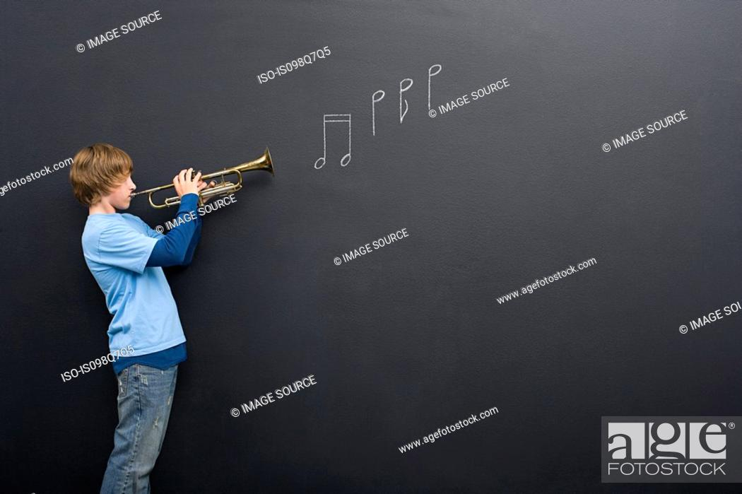Stock Photo: A boy playing the trumpet.
