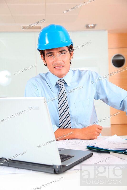 Stock Photo: Portrait of architect wearing security helmet.