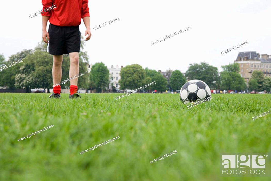 Stock Photo: Footballer and football.