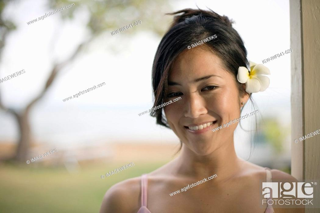 Stock Photo: A young woman smiling.