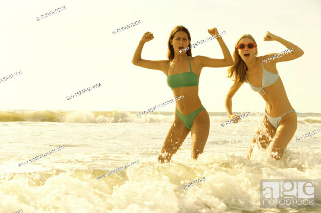 Stock Photo: Portrait of two teenage girls posing on the beach.